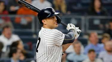 Giancarlo Stanton #27 of the Yankees doubles in
