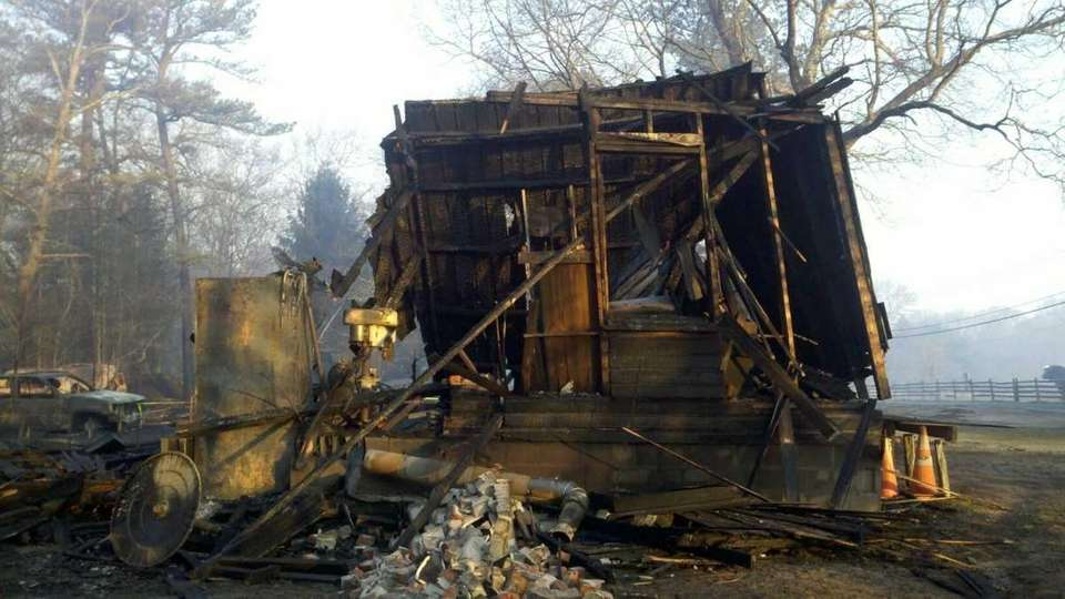 The remains of a burned house and car