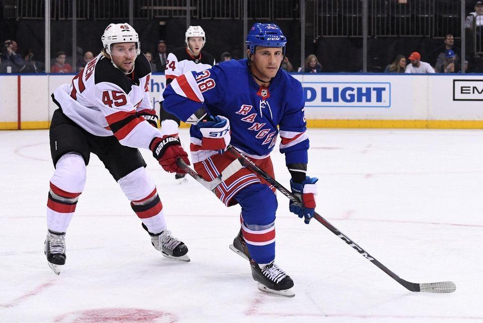 New York Rangers center Michael Haley skates ahead