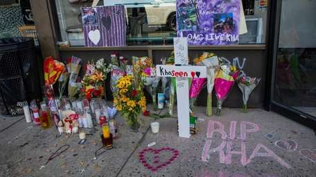 Candles and flowers are left at the scene