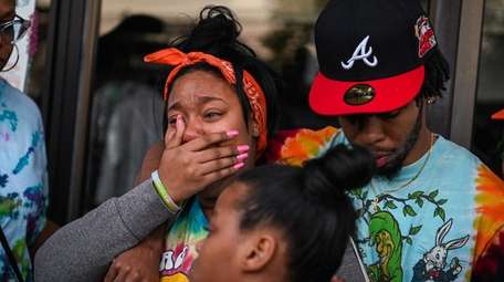 Keyanna Morris and her brother Khaleem Morris mourn