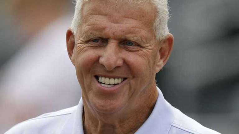 Retired NFL football coach Bill Parcells watches batting