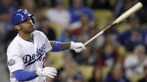 Los Angeles Dodgers' Matt Kemp hits a sacrifice