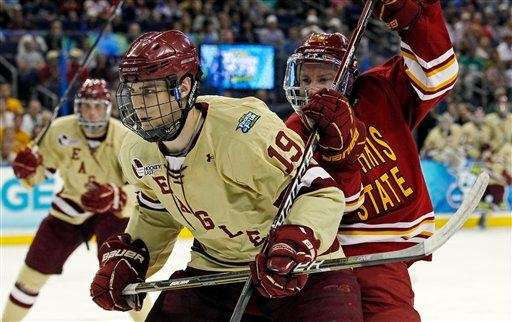 Boston College's Chris Kreider (19) and Ferris State's