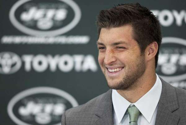 Tim Tebow holds his first news conference with