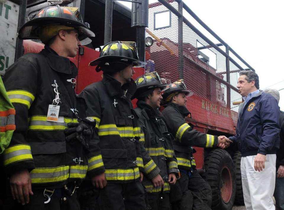 Governor Andrew Cuomo greets firefighters in Manorville. (April