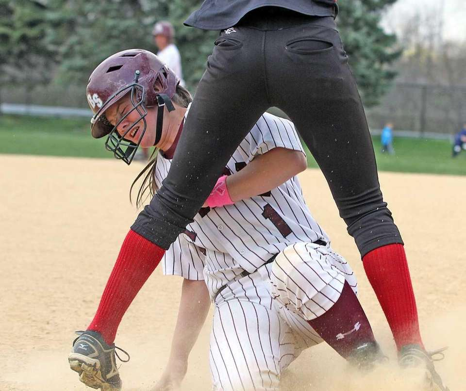 Bay Shore's Courtney Syrett is safe at third.