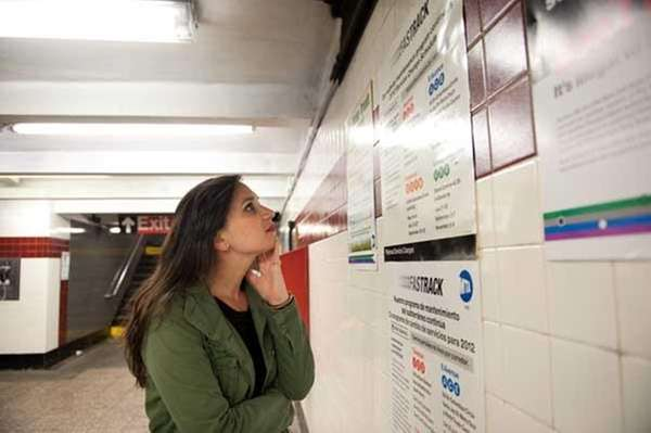 Blair Smith, of Brooklyn, pauses to read subway