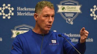 Giants head coach Pat Shurmur speaks with the