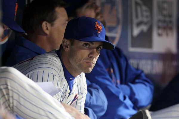 David Wright looks on from the dugout during