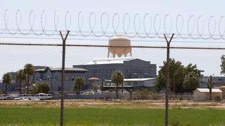 A fence surrounds the state prison in Florence,