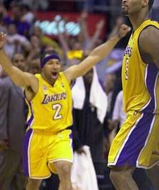 Los Angeles Lakers' Derek Fisher, left, runs on