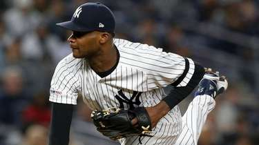 Domingo German of the Yankees pitches against the