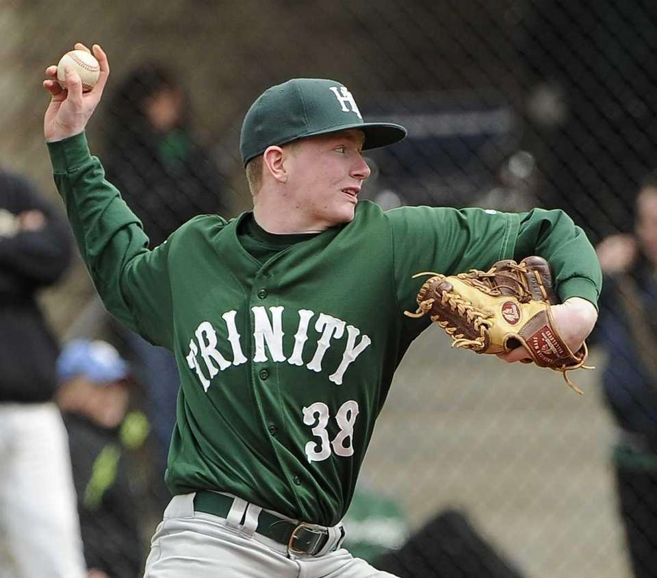 Holy Trinity pitcher Mike Huber throws against St.