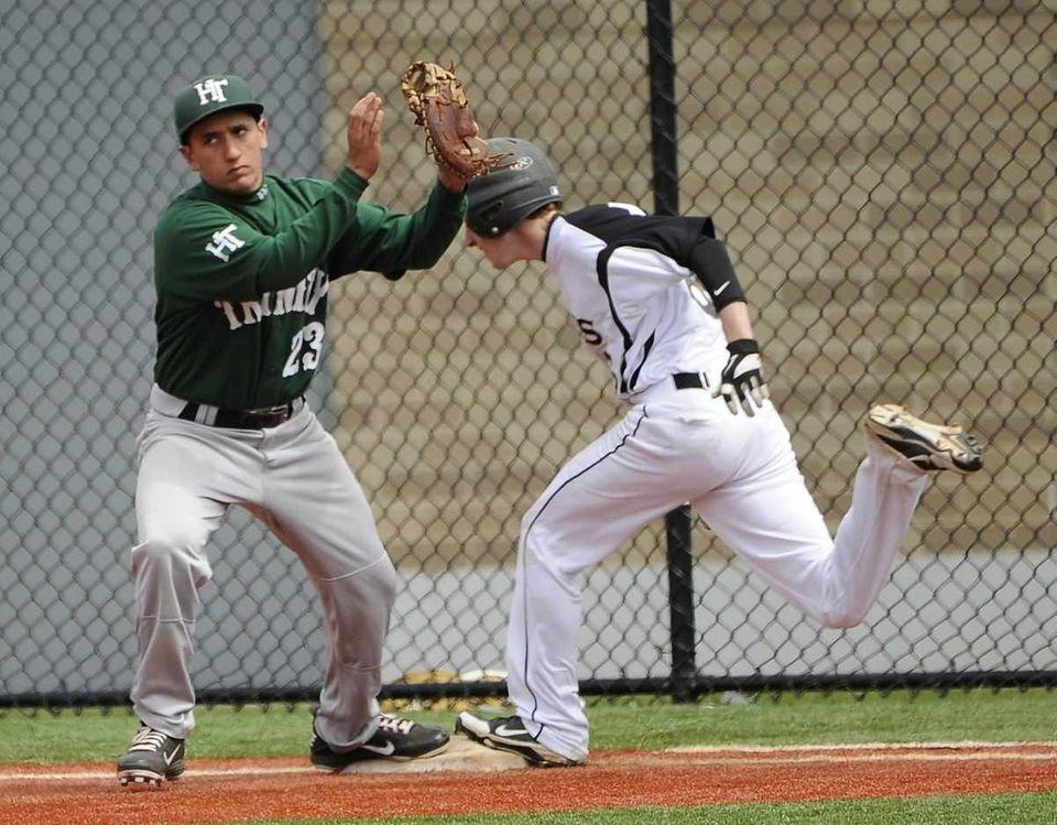 Holy Trinity first baseman Mike Emanuele gets St.
