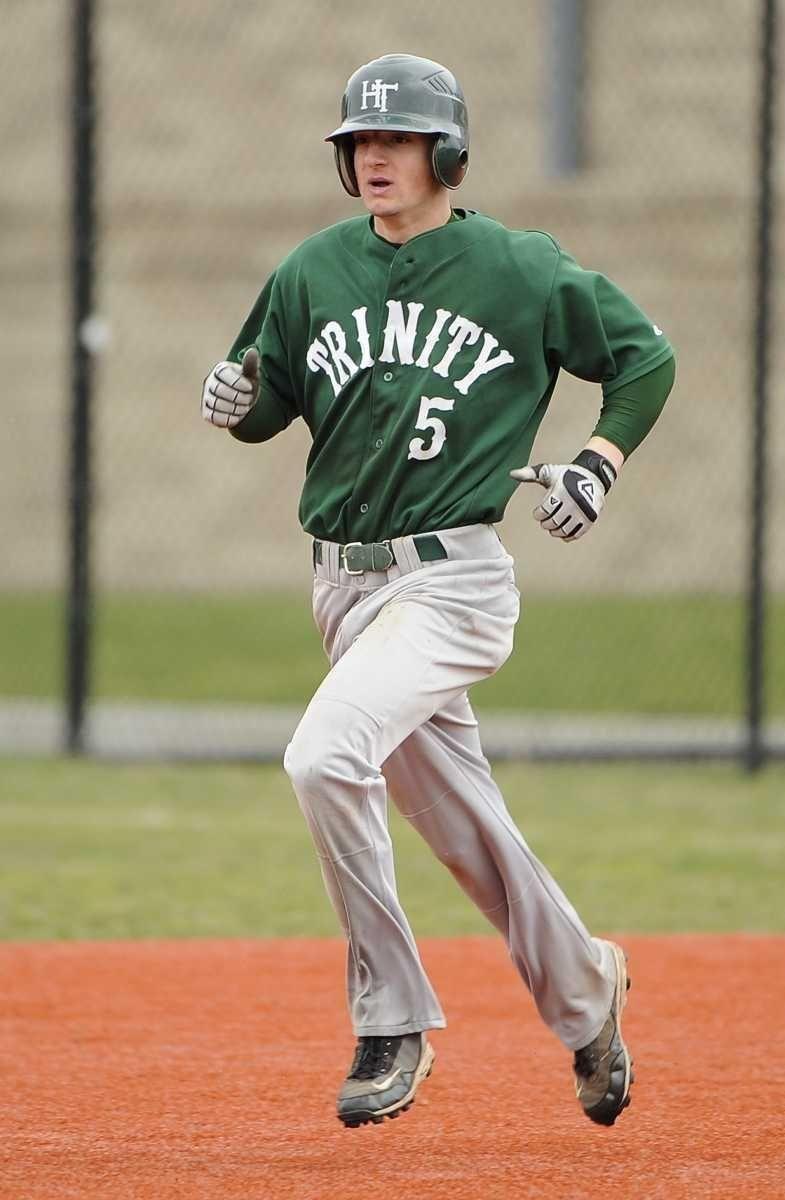 Holy Trinity's Joey Devito runs to second base
