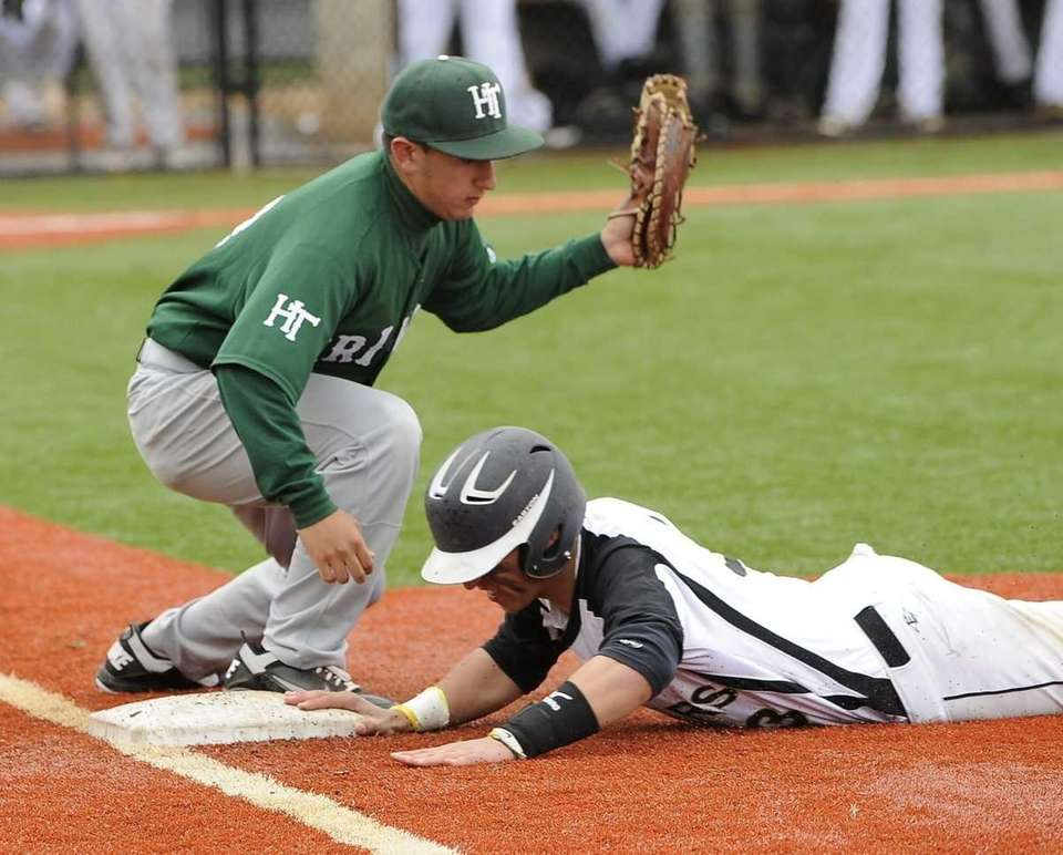 St. Anthony's Alexander Masotto is safe at first