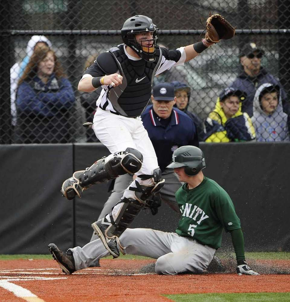 Holy Trinity's Joey Devito crosses home while St.