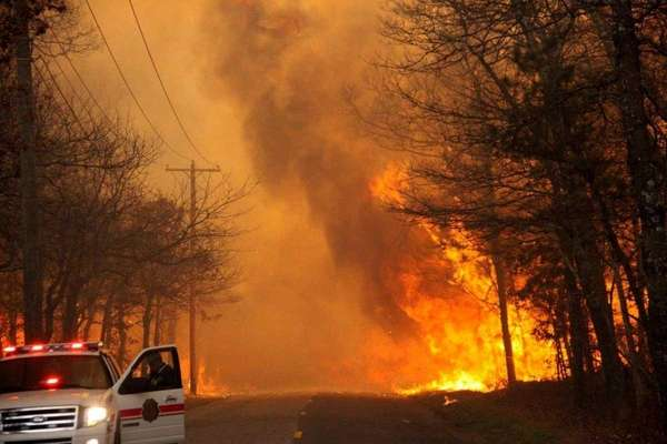 Flames from Suffolk's brush fires jump a roadway