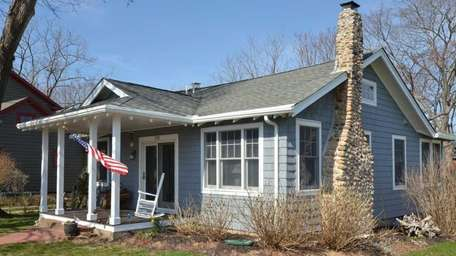 A two-bedroom, one-bath Southold Craftsman cottage on a