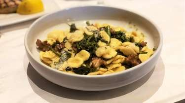 Orecchiette with sausage and broccoli rabe is one
