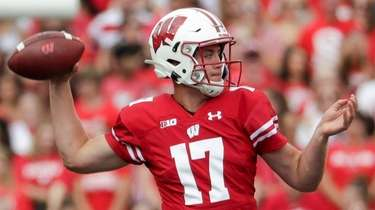 Wisconsin's Jack Coan throws during the first half