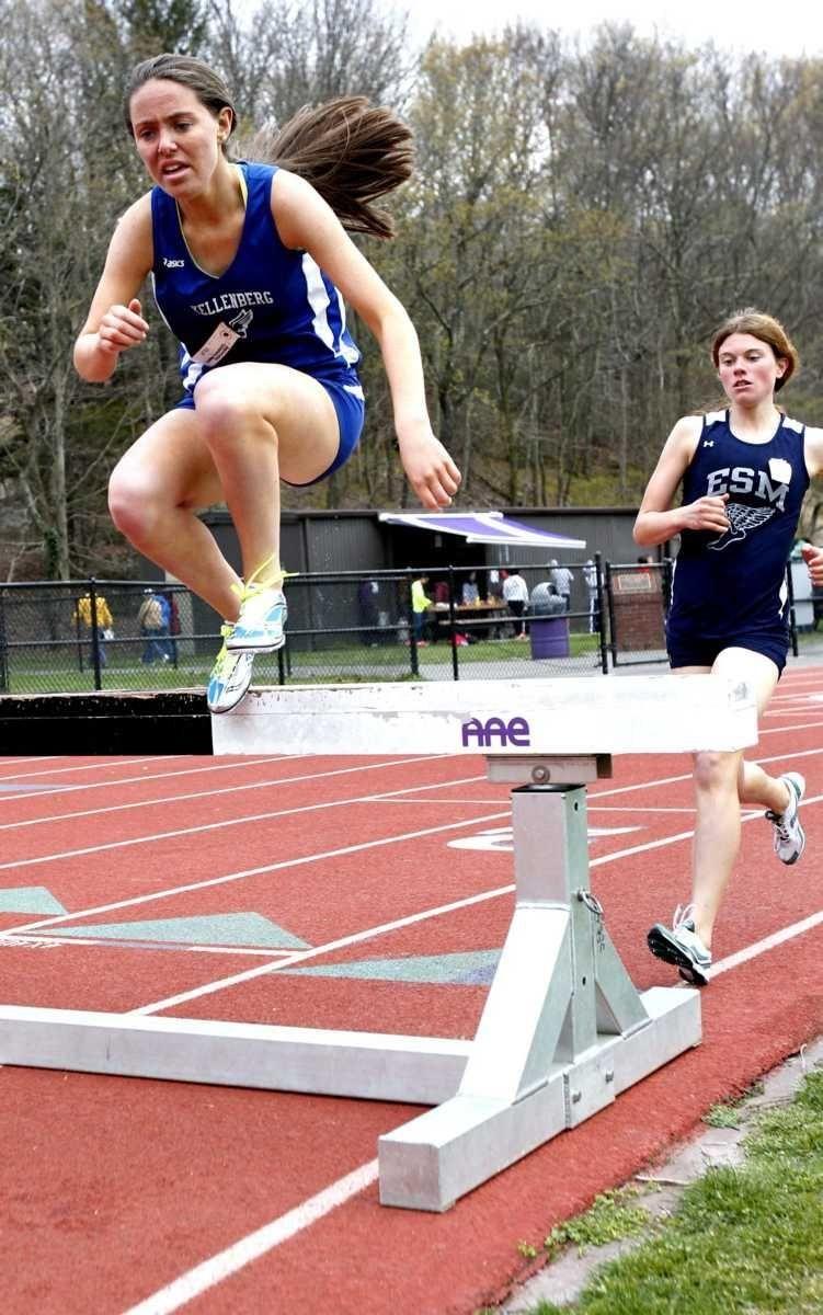 Kellenberg's Ashlin Conroy leads Eastport's Briana Hayes on