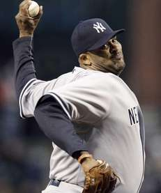 Yankees starting pitcher CC Sabathia throws to the