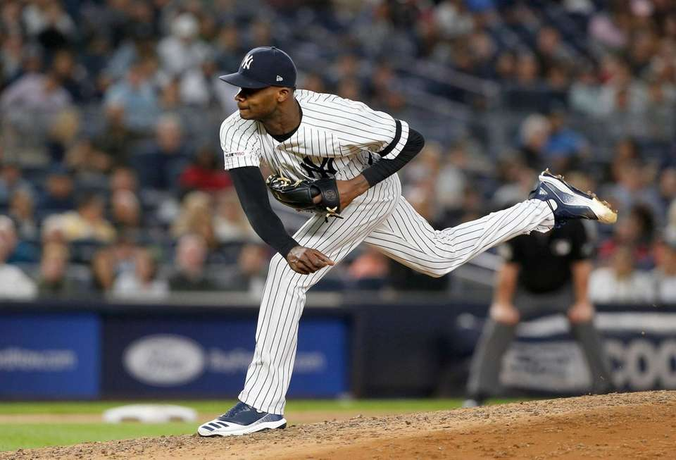 Domingo German of the New York Yankees pitches