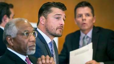 "Iowa farmer and former ""Bachelor"" Chris Soules listens"