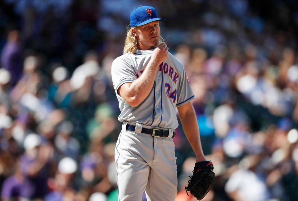 New York Mets starting pitcher Noah Syndergaard reacts