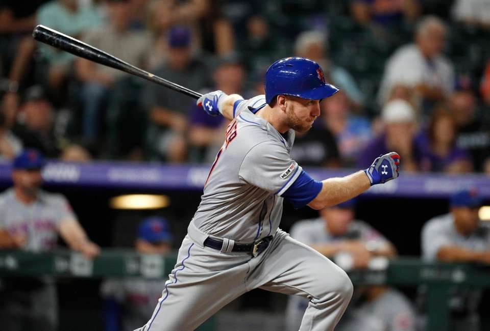 New York Mets' Todd Frazier watches his RBI