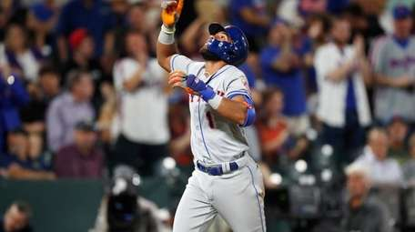 New York Mets' Amed Rosario gestures as he
