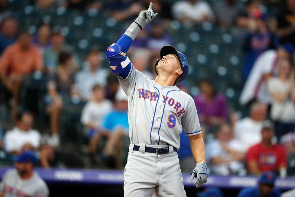 New York Mets' Brandon Nimmo gestures as he