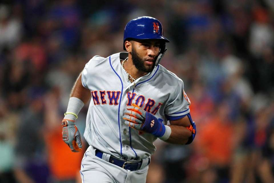 The Mets' Amed Rosario heads up the first