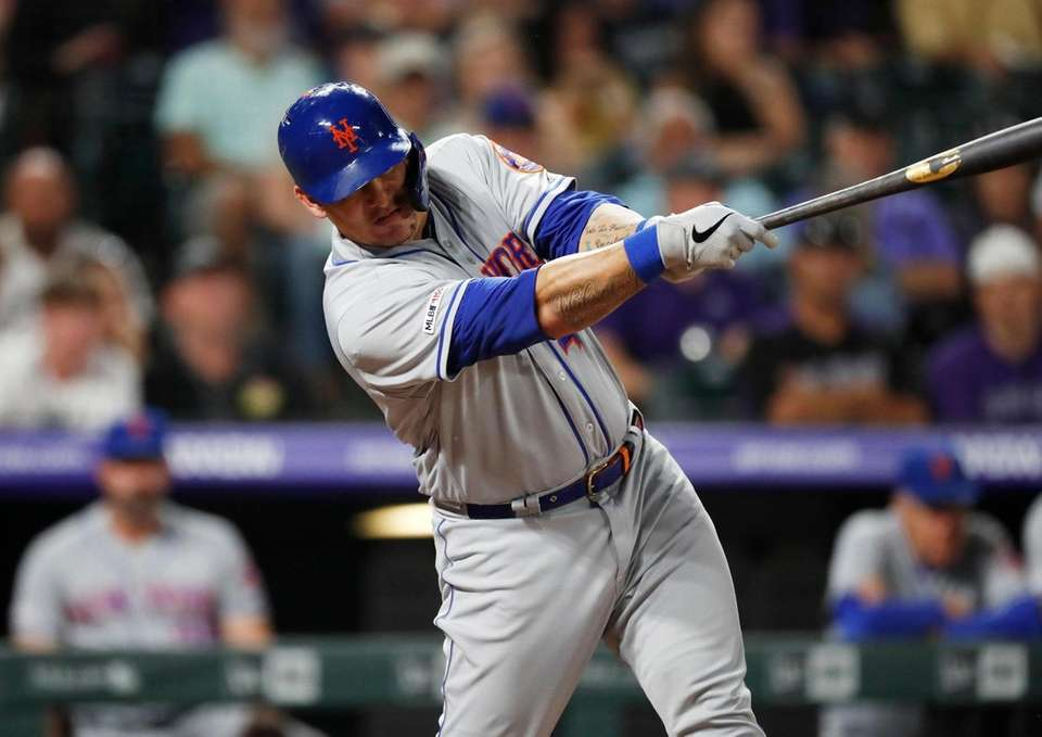 New York Mets' Wilson Ramos singles off Colorado