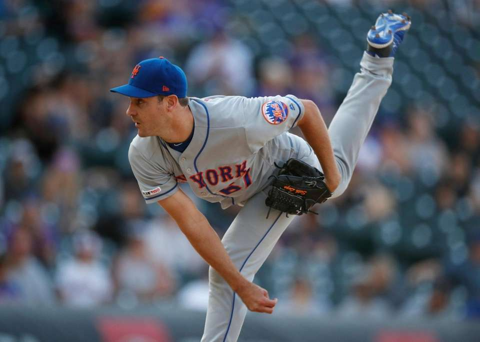 New York Mets relief pitcher Seth Lugo works