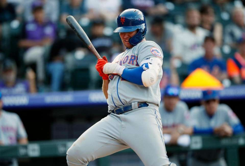 New York Mets' Pete Alonso avoids an inside