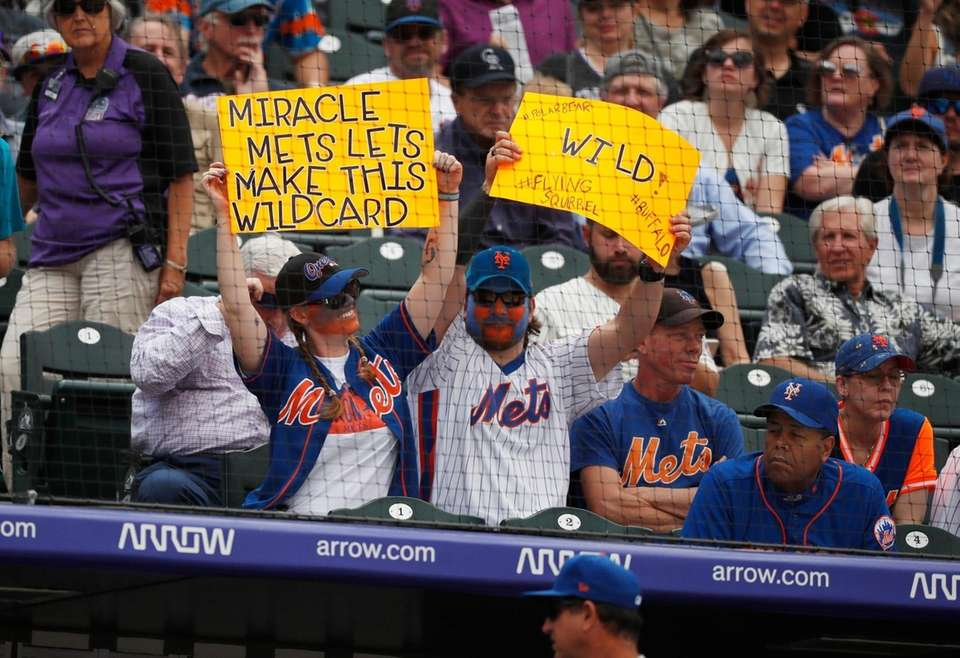 Fans wave placards for the New York Mets