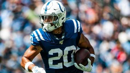 Indianapolis Colts running back Jordan Wilkins (20) carries