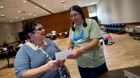 Laurie Farber, right, of Wyandanch, started the Long
