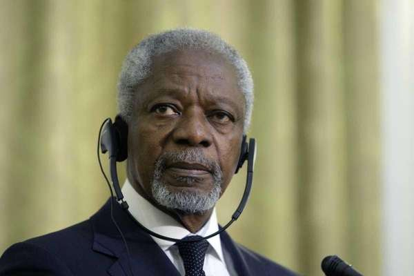 U.N.-Arab League envoy Kofi Annan listens to a