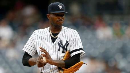 Domingo German of the Yankees stands on the