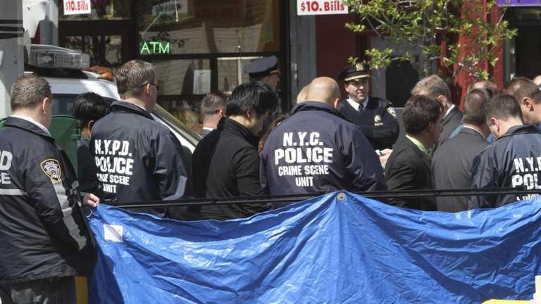 Crime scene unit officers investigate at a crime