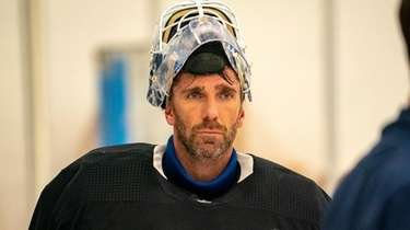 Rangers goalie Henrik Lundqvist looks on during the