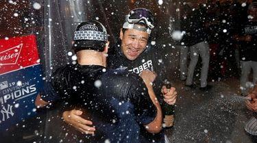 Masahiro Tanaka #19 of the Yankees celebrates in