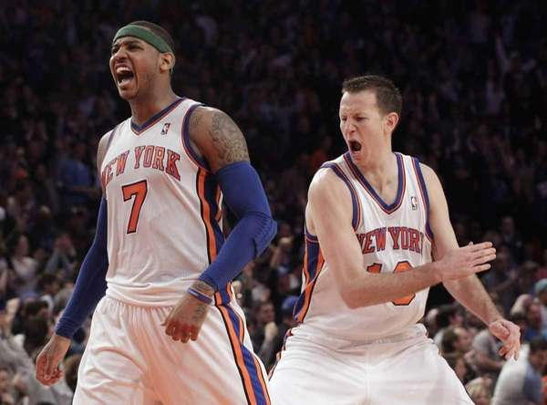 Carmelo Anthony and Steve Novak celebrate after Anthony