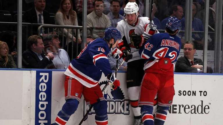 Marc Staal #18 and Artem Anisimov #42 of