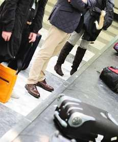 Passengers waiting for their luggage to arrive on
