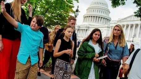 Swedish environmental activist Greta Thunberg, center, on Capitol